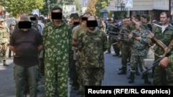 "Correspondents say people watching the August 24 incident in Donetsk shouted ""Fascists!"" and other abuse at the prisoners."