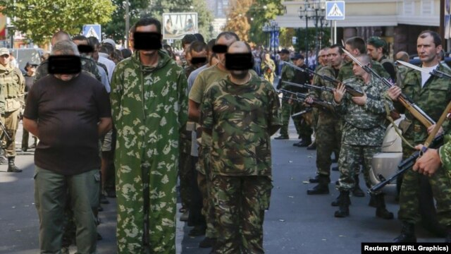 Ukrainian prisoners are paraded by pro-Russian separatists on Ukrainian Independence Day in the eastern city of Donetsk on August 24.