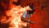 VENEZUELA - demonstrator catching fire during clashes with riot police within a protest against Venezuelan President Nicolas Maduro in Caracas. May 3, 2017