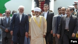 استقبال وزیر خارجه ایران از پادشاه عمان در تهران