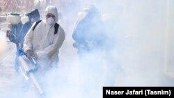 ضدعفونی کردن یکی از خیابانهای تهران پس از شیوع ویروس کرونا