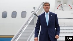 U.S. Secretary of State John Kerry arrives at London's Stansted Airport on September 18.