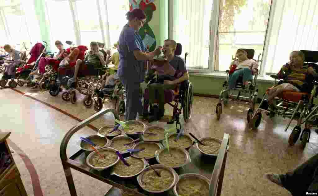 Nurse Lubov Tagai feeds one of the children.