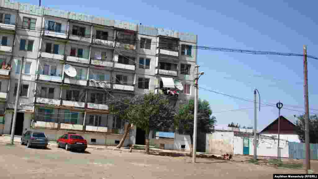 A Soviet-era block of flats in Toretam. The central heating system has not worked for a long time -- people get their water from outside the town and use stoves to heat their apartments.