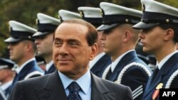 Italian Prime Minister Silvio Berlusconi inspects the honor guard during a welcome ceremony at the White House in October 2008.