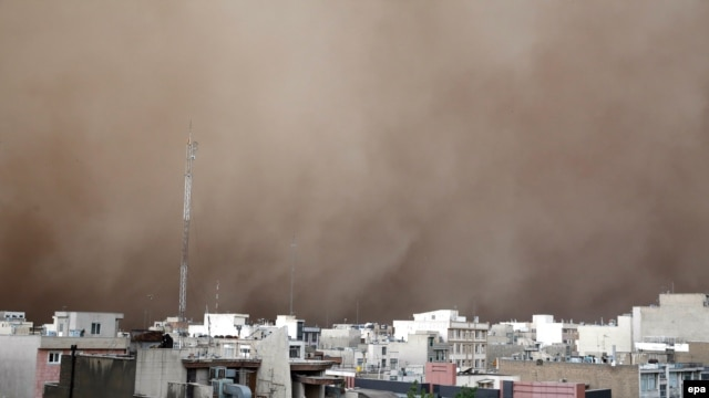 A dust storm engulfs Tehran on June 2. The storm killed five people, injured several dozen more, and knocked out power to around 50,000 homes in the Iranian capital.