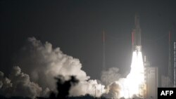 "An Ariane-5 rocket blasts off from French Guiana on March 23, carrying the ""Edoardo Amaldi"" cargo vessel."