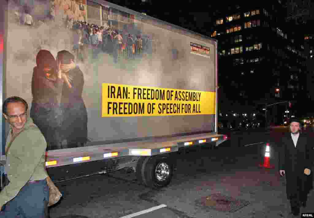 A truck in New York bears a poster challenging alleged official abuses since Iran's disputed election in June.