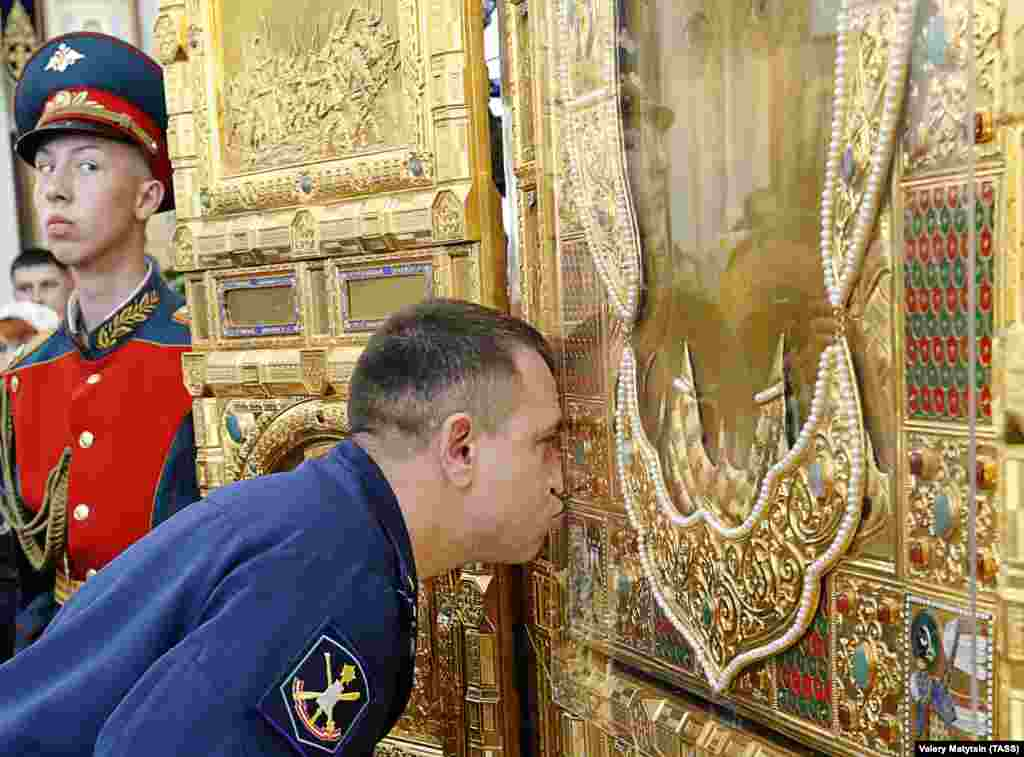 A serviceman kisses the main icon at a Russian Armed Forces cathedral in Rostov-on-Don. (TASS/Valery Matitsin)