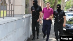 Armenia - Masked policemen accompany Tigran Khachatrian, the son of Syunik Governor Surik Khachatrian, to a Yerevan court, 27Jul,2015