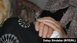 """""""I don't even want to see a man. I just can't,"""" says Nasiba, 34, an Uzbek woman who says she was raped by a group of Kyrgyz men during the June 2010 ethnic clashes in Osh."""
