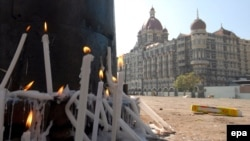 Candles outside the Taj Mahal Hotel, site of one of the bloodiest attacks