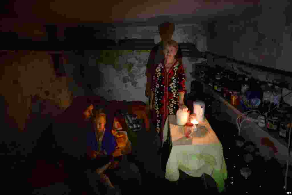 A familly hides in the basement of their house as they turned it into a shelter from shelling in the eastern Ukrainian town of Slovyansk on June 25. (epa)