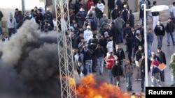 Pamje nga protestat në Tunizi.