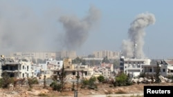 Smoke rises from the government-controlled New Aleppo neighborhood in western Aleppo city on November 3.
