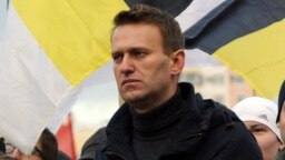 """A picture taken on November 4, 2011, in the southeastern outskirts of Moscow shows influential blogger Aleksei Navalny taking part in the so-called """"Russian March,"""" which marks National Unity Day."""
