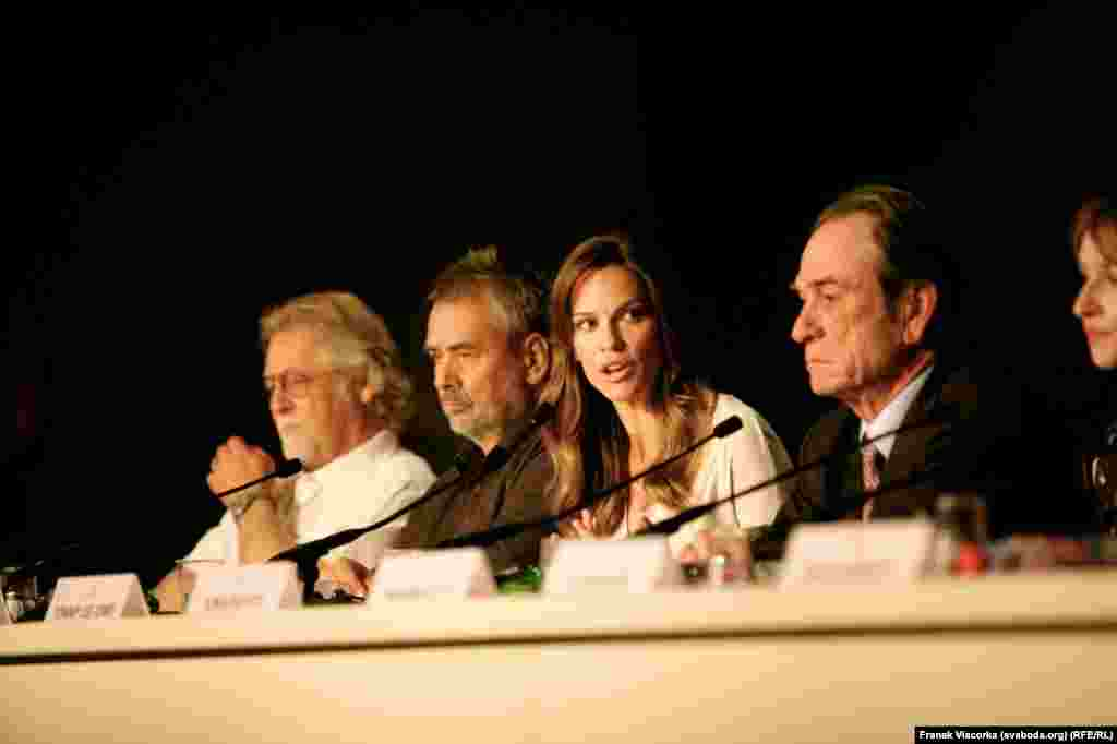 "Tommy Lee Jones (right), the star and director of the film ""The Homesman,"" and co-star Hilary Swank speak to journalists."