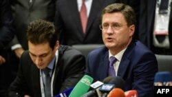 Russian Energy Minister Aleksandr Novak (right) speaks during a press conference during the 23rd World Energy Congress on October 12.