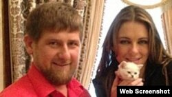 Chechen leader Ramzan Kadyrov (left) with actress Elizabeth Hurley and a white kitten in 2013.