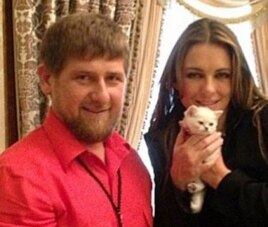Kadyrov and Hurley pose with a kitten on Kadyrov's Instagram account.