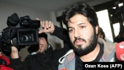 Reza Zarrab, a dual citizen of Turkey and his native Iran, is surrounded by journalists as he arrives at a police center in Istanbul in December 2013. Will his U.S. trial expose facts Turkey's president would rather not be made public?
