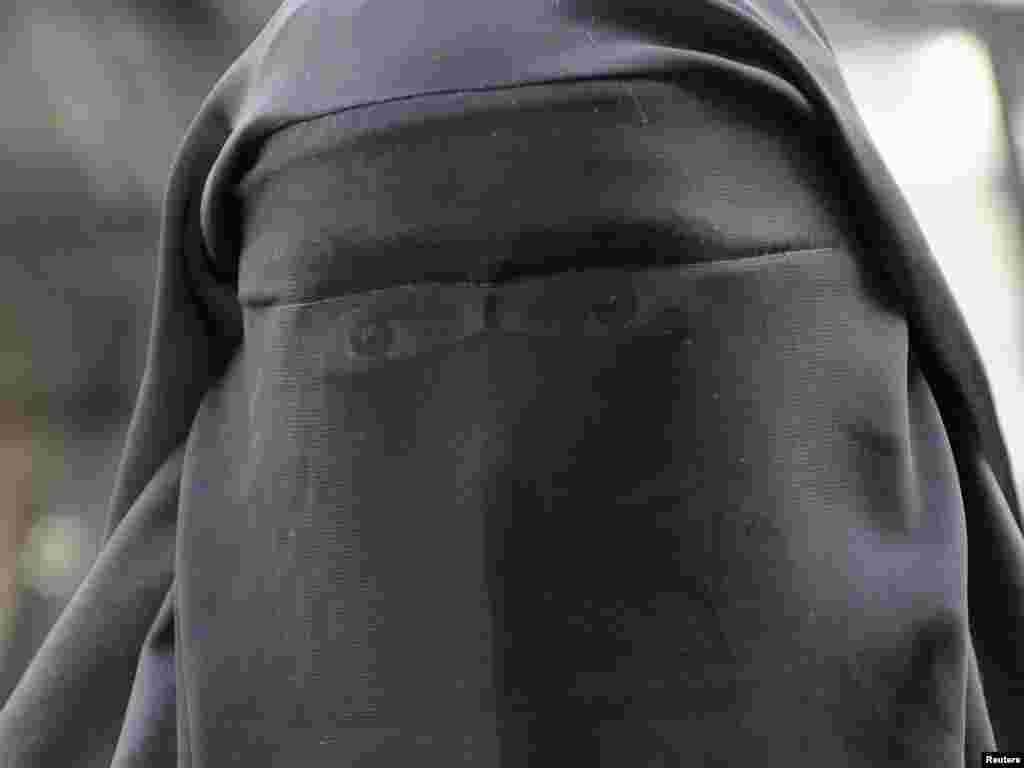 A woman who identified herself as Nayet, wearing a burqa, is seen after her release from a police station in Paris on April 11. France's ban on full face veils, a first in Europe, went into force, exposing anyone who wears the Muslim niqab or burqa in public to fines of 150 euros ($216) and lessons in French citizenship. Photo by Gonzalo Fuentes for Reuters