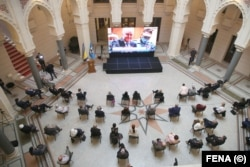People in Sarajevo watch a live broadcast from The Hague to learn the verdict for Bosnian Serb military chief Ratko Mladic in Sarajevo City Hall on June 8.
