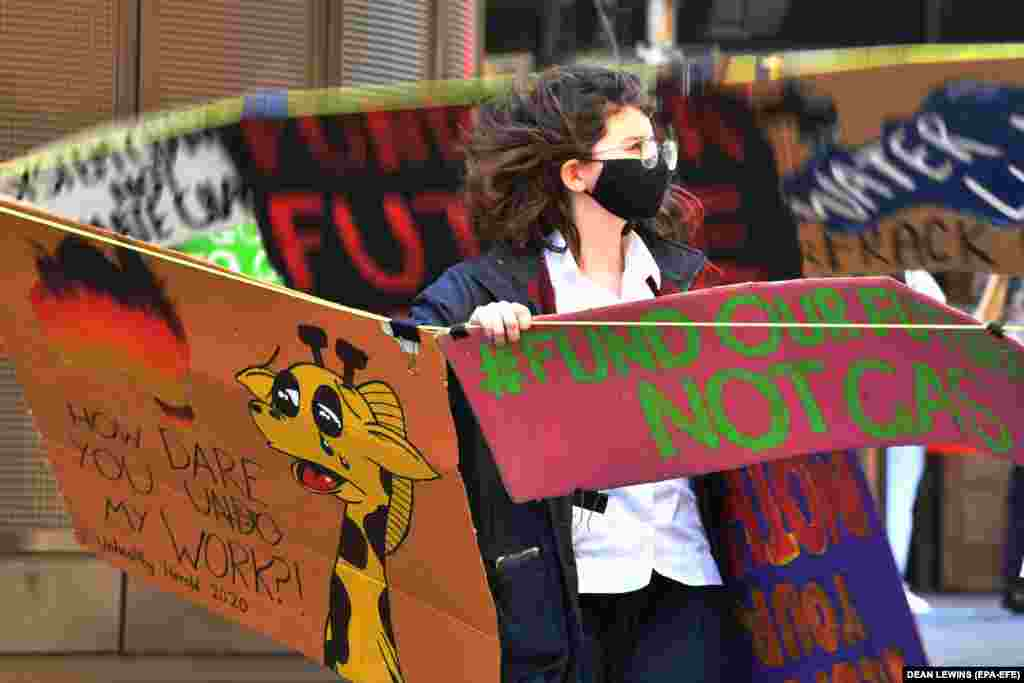 A person takes part in 'Fund Our Futures Not Gas' climate rally in Sydney, Australia, September 25, 2020. In Australia, thousands of students took part in about 500 small gatherings and online protests, to demand investment in renewable energy and oppose funding for gas projects.
