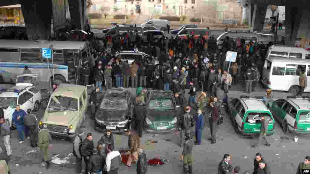 Onlookers gather at the site of a powerful explosion in the Midan neighborhood of Damascus, Syria. AFP PHOTO/HO/SANA