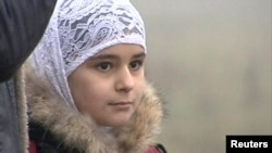 A young girl wear Islamic-style head scarf in Stavropol, in sourthern Russia.