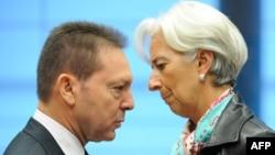 Грчкиот министер за финасии Јанис Стурнарас и шефицата на ММФ Кристин Лагард.