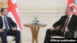Վրաստանի վարչապետ Իրակլի Ղարիբաշվիլին և Ադրբեջանի նախագահ Իլհամ Ալիևը: Բաքու, 10-ը հոկտեմբերի, 2015 թ․
