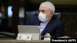 Iranian Foreign Minister Mohammad Javad Zarif wearing a protective mask during a cabinet meeting in Tehran.