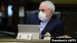 Iranian Foreign Minister Mohmmad Javad Zarif wears a protective mask during a cabinet meeting in Tehran on March 11.