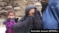 Saima (right), an Afghan widow, with her two daughters. Her husband was a Taliban fighter.