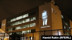Czech Republic – The image of Vaclav Havel is projected on the front of the RFE/RL building in Prague, 21Dec2011