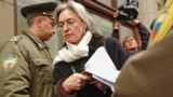 "RUSSIA -- Journalist and human rights advocate, Anna Politkovskaya appears outside the waiting room of the presidential administration where a protest action ""Under Siege-2: Empty Space"" was held. The action was staged by parents of National Bolshevik Par"