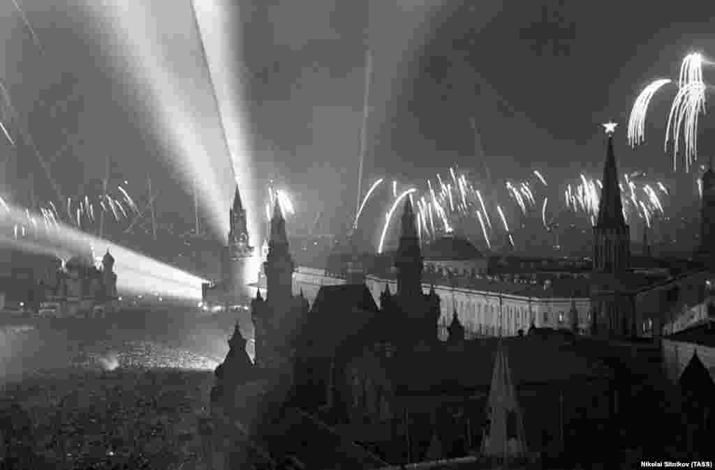 "Moscow's Red Square, packed with people as fireworks explode around the Kremlin. One man who was there later told Russian media ""Strangers kissed each other. I don't remember such a unity of people as it was on May 9, 1945; we were all one and the same -- Russians, Tatars, Uzbeks, and Georgians -- we were all united as never before."""