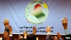 Iraq -- Members of Parliament raise their hands as they vote on a resolution, 10May2006