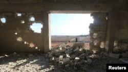 Разрушенное здание в городе Саракиб в сирийской провинции Идлиб.