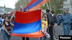 Opposition supporters march in Yerevan on May 1.