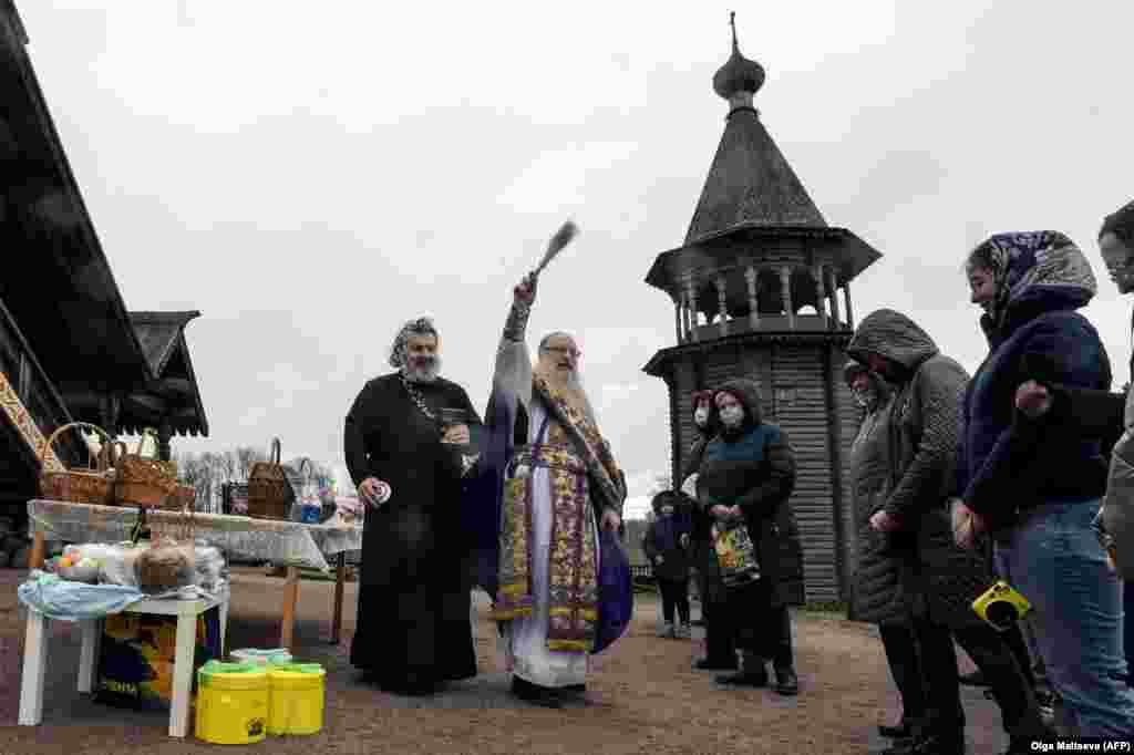 An Orthodox priest blesses traditional cakes and eggs at Pokrovsky Cathedral in St. Petersburg, Russia, on April 18.