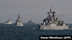 Warships of the NATO Standing Maritime Group-2 take part in a military drill in the Black Sea off the coast of Romania in March 2015.