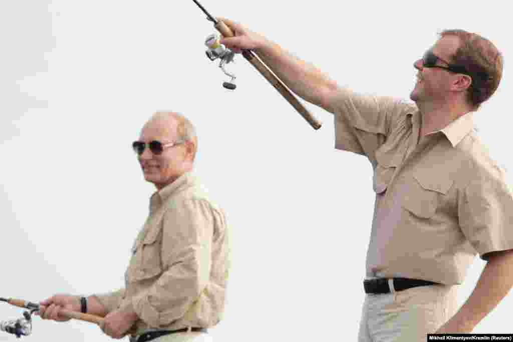 The two leaders take a fishing trip together on the Volga River in Russia's Astrakhan region on August 16, 2011. Ahead of the presidential election in 2012, Medvedev said he would step aside to allow Putin to become United Russia's candidate. Putin won the election and returned to the presidency on May 7, 2012, naming Medvedev as prime minister the same day.