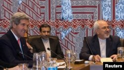 U.S. Secretary of State John Kerry (left) and Iran's Foreign Minister Mohammad Javad Zarif (far right) during a meeting at UN headquarters in September.