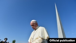 Pope Francis visits the Armenian genocide memorial in Yerevan on June 25.