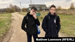 Fifteen-year-old Danil Smirnov (right) says there are only six teenagers left in the village.