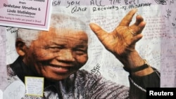 A poster of former South African President Nelson Mandela from well-wishers is filled with encouraging messages outside the Medi-Clinic Heart Hospital where he is being treated in Pretoria.