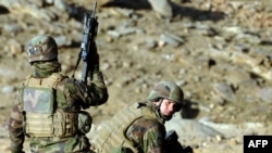 French soldiers take up positions during an operation in Afghanistan's Uzbin Valley. France has 4,000 troops in Afghanistan.