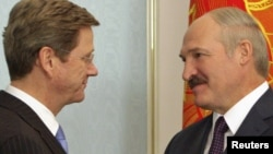 "Belarusian President Alyaksandr Lukashenka (right) welcomes German Foreign Minister Guido Westerwelle to Minsk last month, one of his new EU ""best friends."""